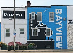 Discover Bayview mural on the side of a dental office on Eastern Avenue near the intersection with Dundalk Avenue.