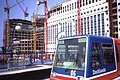Docklands Light Railway - DLR P86 Car 06 at Heron Quays with Tower Cranes, Aug 1990.jpg