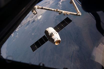 Dragon approaches the ISS (32269420323).jpg