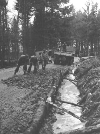 Operation Queen - Engineers repairing a muddy road in the Hürtgen Forest