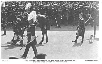 Caesar (dog) - Caesar, accompanied by a highlander, at the King's funeral procession