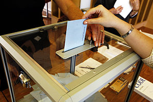 Democracy - A person casts vote in the second round of the 2007 French presidential election.