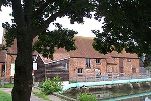 Eling Tide Mill - The mill from beside mill pond, with the toll hut in foreground.