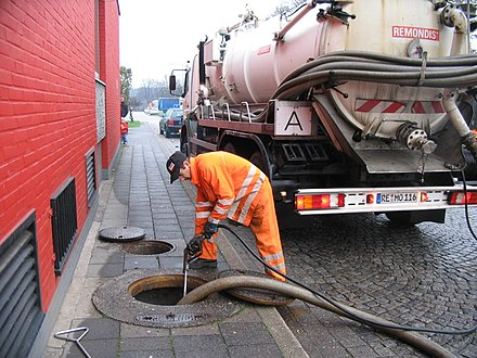 A vacuum truck used to empty septic tanks in Germany Emptying of a tank full with sewage by vacuum truck (2921521126).jpg