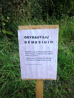 A sign in a Lithuanian forest warning of high risk of tick-borne encephalitis infection Erkinis encefalitas, Pasusvio miskas.JPG
