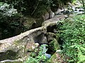 Erroded stones near the water fall - panoramio.jpg