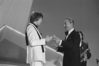 Marcel Bezençon - Bezençon (right) congratulates Johnny Logan after winning the 1980 Eurovision Song Contest