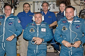Walker (bottom left) following her arrival aboard the ISS. Expedition 24 inflight crew portrait.jpg