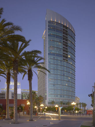 Curtain wall (architecture) - The Omni San Diego Hotel curtain wall is an example of a modern unitized curtain wall system with integrated sunshades.
