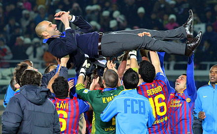 Pep Guardiola is hoisted in the air after Barcelona won the 2011 FIFA Club World Cup, crushing Santos 4-0 in the final. FC Barcelona Team 2011.jpg