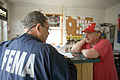 FEMA - 30342 - FEMA field worker talking to a resident of New Jersey.jpg