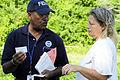 FEMA - 35389 - Community Relations specialist talks to homeowner.jpg