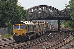 Fairwater - Freightliner 66507 leaving with ballast train.jpg