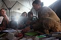 Flickr - Official U.S. Navy Imagery - Navy medic works with Afghan children during a health training initiative..jpg