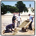 Flickr - USCapitol - An improved reflection, AOC masons making repairs to drained Capitol Reflecting Pool..jpg