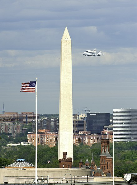 The Space Shuttle Discovery and the Washington Monument prior to landing at Dulles International Airport Flickr - USCapitol - Shuttle Discovery Flying by the Washington Monument.jpg