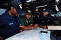 Football players in USS George HW Bush bridge 130203-N-HM829-050.jpg