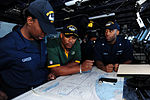 Football players in USS George HW Bush bridge 130203-N-HM829-050.jpg