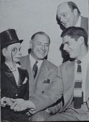 Fritz Crisler and Bob Chappuis pose with Charlie McCarthy and Edgar Bergen.jpg
