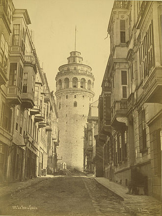 Galata Tower - Albumen print of the Galata Tower, taken by Pascal Sébah some time between 1875–1886. Here the tower has the cupola that was built after the storm of 1875. The present-day conical top is a reconstruction of a previous one, and was built during restoration works between 1965 and 1967.