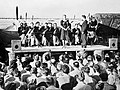 Geraldo and his orchestra, fronted by the singer Dorothy Carless, entertain airmen at an airfield in North Africa, 1943. CM5442.jpg