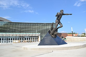 Breslin Student Events Center - Magic Johnson statue, along with the Gilbert Pavilion in the background