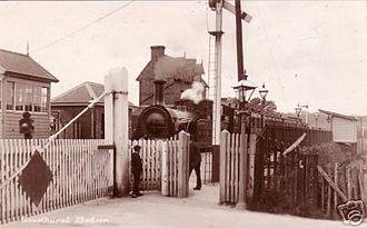 Hawkhurst branch line - Goudhurst station, 1930s. Signal box at left and level crossing gates bottom left.
