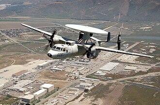 Naval Base Ventura County - An E-2C Hawkeye flies over NBVC Point Mugu