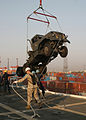 Gunnery Sgt. Brown Assists Sailors With the Offloading of a Seven-ton Truck DVIDS11680.jpg