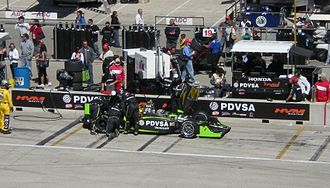 HVM Racing - The HVM team repairs E. J. Viso's car at the Milwaukee Mile in 2009