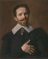 Portrait of a man with his hand on his heart