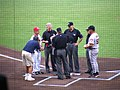 Handing the rosters to the umpires (199532054).jpg