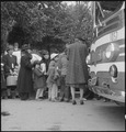 Hayward, California. Farm families of Japanese ancestry are being checked into the evacuation buses . . . - NARA - 537521.tif