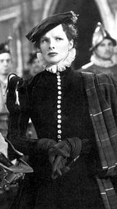 Hepburn dressed in medieval clothes, standing with a concerned look on her face.