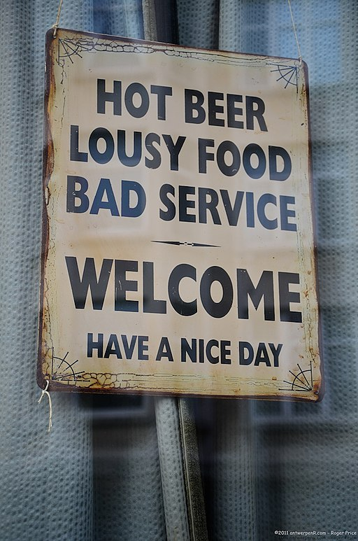 Hot beer, lousy food, bad service - Welcome, have a nice day sign in Antwerp, Belgium