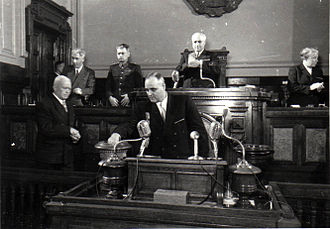 1952 Constitution of Romania - General Secretary and Prime Minister Gheorghe Gheorghiu-Dej (at microphones) and head of state Petru Groza (at left) cast their ballots in favour of the Constitution.