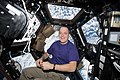 ISS-55 Ricky Arnold rests inside the Cupola.jpg