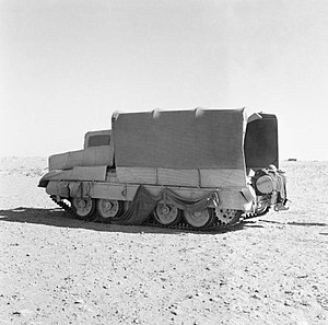 Operation Bertram - A Crusader tank in open desert, masquerading as a truck in its 'Sunshield'