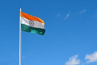Flag of India - The flag of India showcases three colors in a horizontal fashion: saffron, white and green with an Ashoka Chakra in the middle.