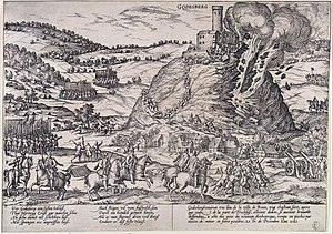 Gebhard Truchsess von Waldburg - Destruction of the fortress above the village of Godesberg during the Cologne War 1583; the walls were breached by mines, and most of the defenders were put to death. Engraved by Franss Hogenberg, a Dutch engraver and artist of the 16th century.