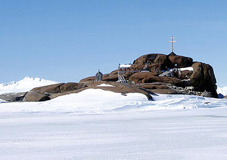 Religion in Antarctica - View of the cemetery on Buromsky Island with its Orthodox cross and Ivan Khmara's Stone on the island