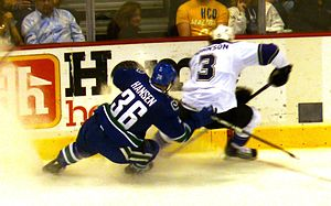 Jannik Hansen - Hansen pursues Los Angeles Kings defenceman Jack Johnson along the boards during the 2010 playoffs.