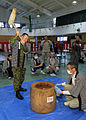 Japan Ground Self Defense Lt. Gen. Masahiro Hidaka, the commander of the Central Readiness Force, pounds clumps of sticky rice with a wooden mallet, turning it into mochi, a popular type of rice cake, during 131218-A-OO766-102.jpg