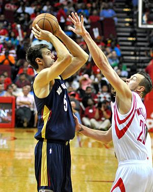 Jeff Withey - Withey looks to shoot as Donatas Motiejūnas defends during a preseason game in October 2013.