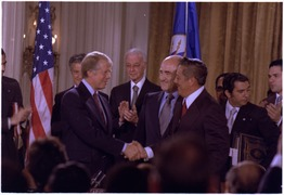Jimmy Carter and General Omar Torrijos shake hands after signing the Panama Canal Treaty. - NARA - 176083.tif