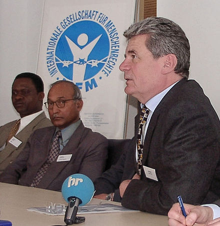 Joachim Gauck attending a press conference of the International Society for Human Rights, where he lectured about the Stasi campaign to discredit the Society Joachim Gauck IGFM 01.jpg