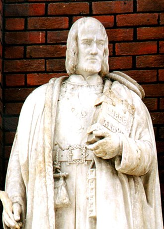 "Town Clerk of London - Statue of John Carpenter (1372–1442)- Resides on a plinth in the City of London School. He is also the author of ""Liber Albus"" which he is shown holding in his hand."