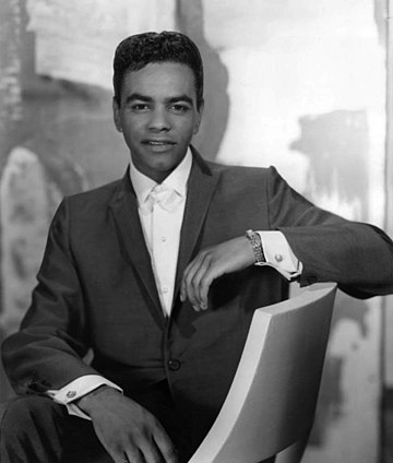 Johnny Mathis concentrated on romantic readings of jazz and pop standards for the adult contemporary audience of the 1960s and 1970s. Johnny Mathis 1960.JPG