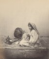 KITLV 100497 - Unknown - Woman with a spinning wheel in British India - Around 1870.tif
