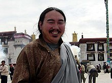 Karma Sumdrup, Tibetan environmentalist and businessman, in front of Jokhang, Lhasa on 5 July 2010.jpg